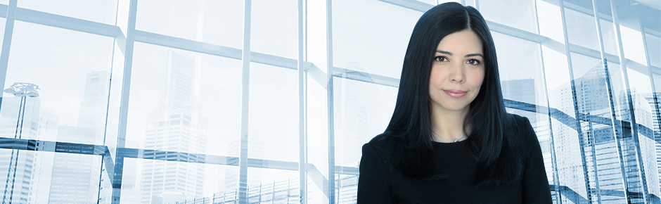 Lawyer (Erika) with large bank of windows in background